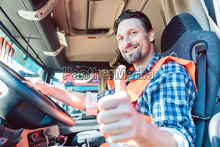 truck driver sitting in cabin giving