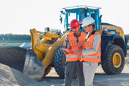 man and woman worker on construction