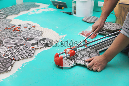 tiler cutting tile with cutter