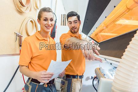 master carpenter explaining maintenance of machine