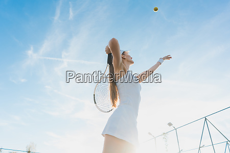 woman serving the ball for a