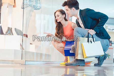 woman and man looking at fashion