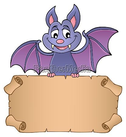 bat holding parchment image 1