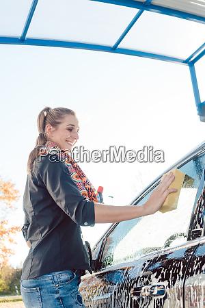 woman foaming her car