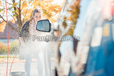 woman using high pressure nozzle to