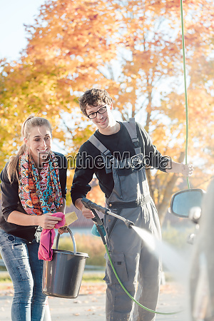 service man helping woman cleaning her