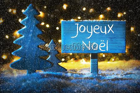blue tree joyeux noel means merry