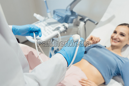 gynecologist attempting ultrasonic examination of patient