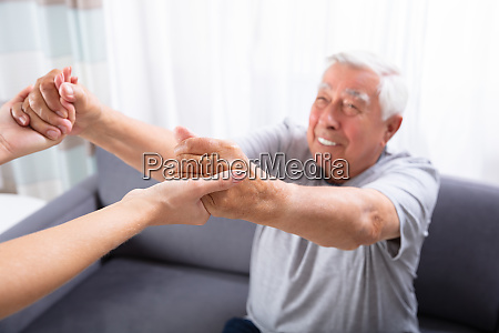 daughter holding hands of her father