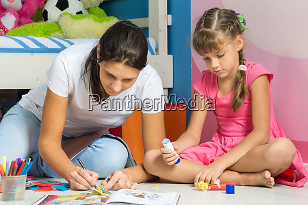 mom and daughter sitting on the