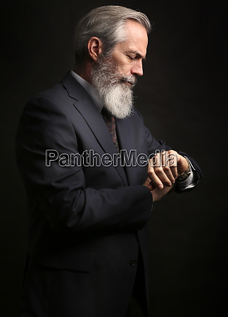 mature male model wearing suit with