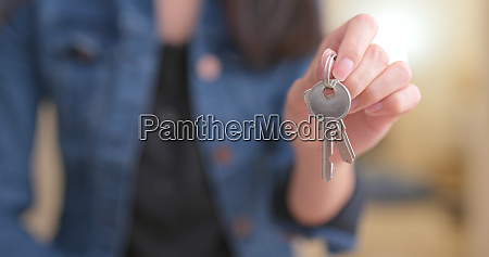 woman holding key at home