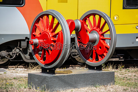 red locomotive wheels with axis