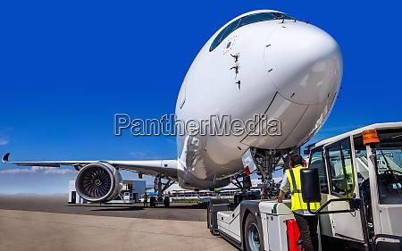 modern airplane gets prepared for take