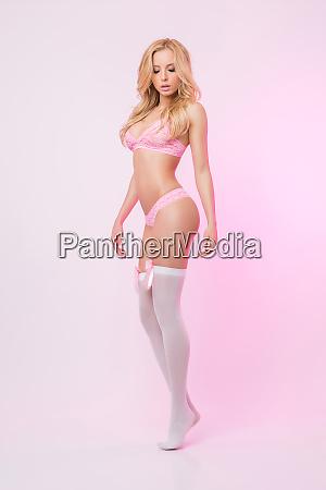 cute slim girl in pink lingerie