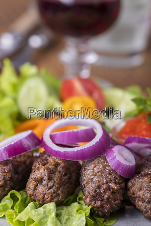 closeup of cevapcici on a plate