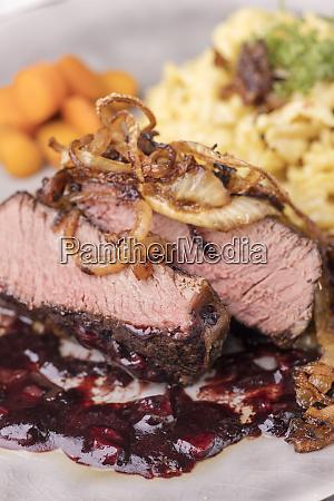 zwiebelrostbraten a german steak with onions