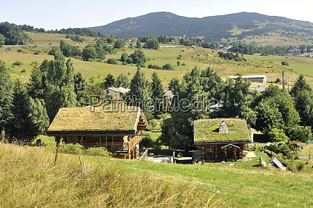wooden chalet with a roof with