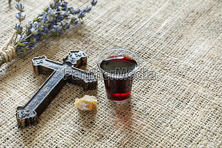taking communion with glass of wine