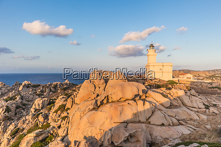 lighthouse on granite rock formations at