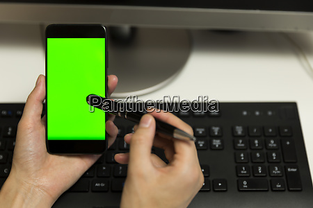 womens hands touches phone screen with