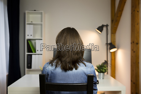 woman sitting by the table at