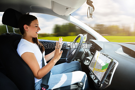 woman sitting in self driving modern