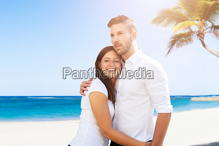 smiling woman embracing her husband