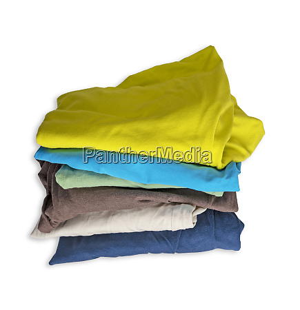 stack of worn multicolored clothes isolated