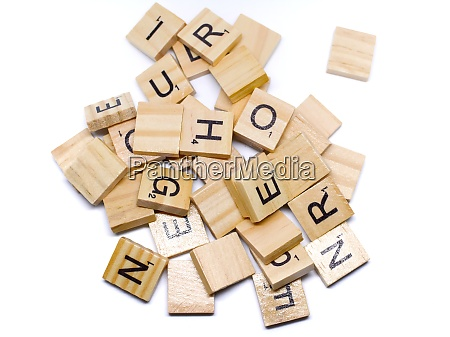 the wooden alphabets with a black
