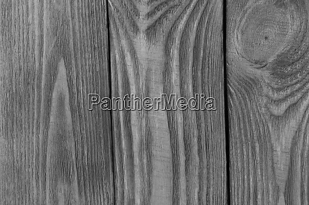monochrome textural background of wooden boards