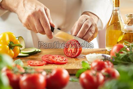 chef preparing a fresh italian salad