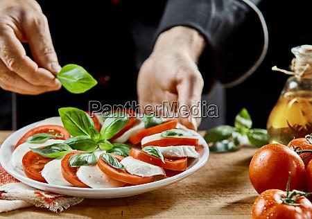 hands of a chef preparing a
