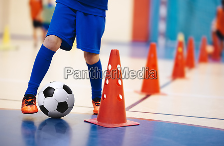 indoor soccer players training with balls