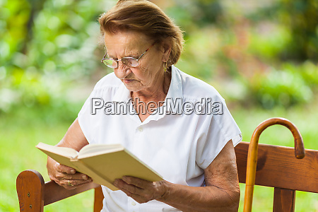 elderly woman sitting and relaxing on