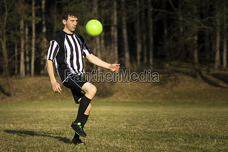 playing soccer player