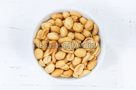 peanuts nuts from above bowl wooden