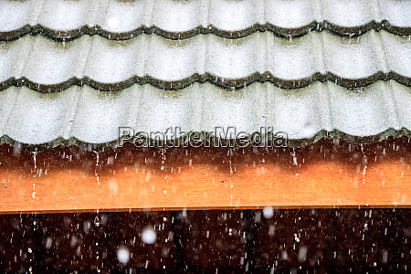 rain flows down from a roof