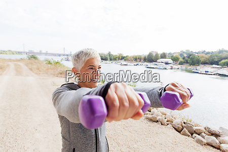 fitness senior woman working with weights