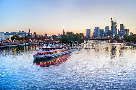 frankfurt skyline and touristic boat
