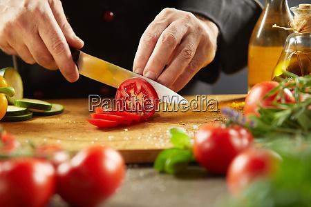 chef preparing a healthy salad with