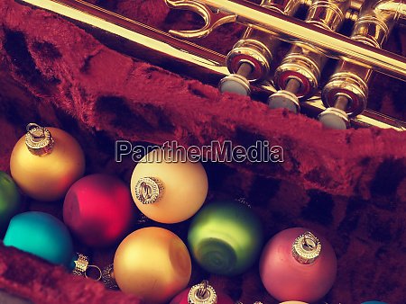 colorful christmas baubles with an old