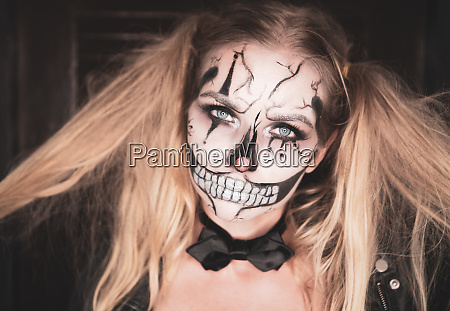 woman with clown skull halloween makeup