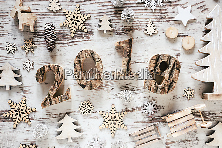 white christmas decoration text 2019 rustic