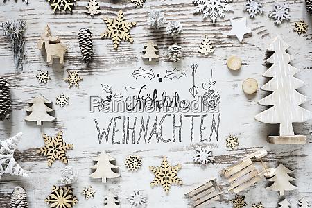 calligraphy flat lay froehliche weihnachten means