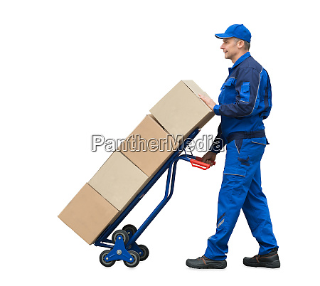 delivery man carrying cardboard boxes on