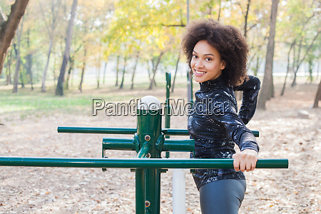 pretty afro woman exercise at outdoor
