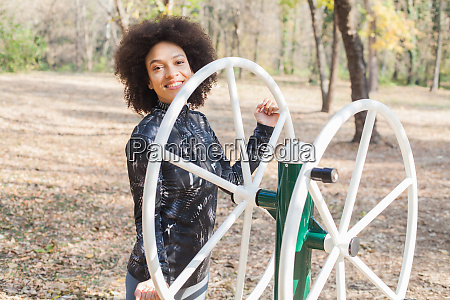 smiling mixed race young woman exercise