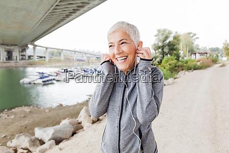 happy mature woman relax listening music