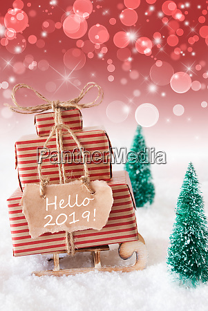 vertical christmas sleigh on red background